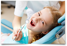girl getting routine teeth cleaning